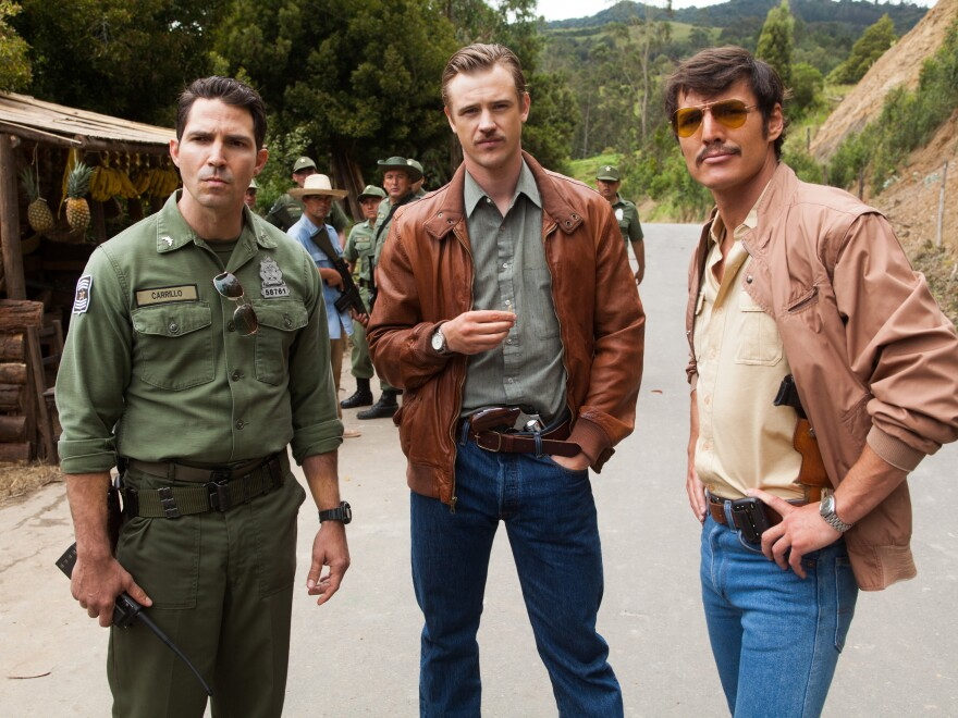 <em>Narcos</em> tells the story of the hunt for Pablo Escobar — a hunt in which DEA agents Steve Murphy (Boyd Holbrook, center) and Javier Peña (Pedro Pascal, right) worked closely with Colombian police. (Also pictured: Maurice Compte).
