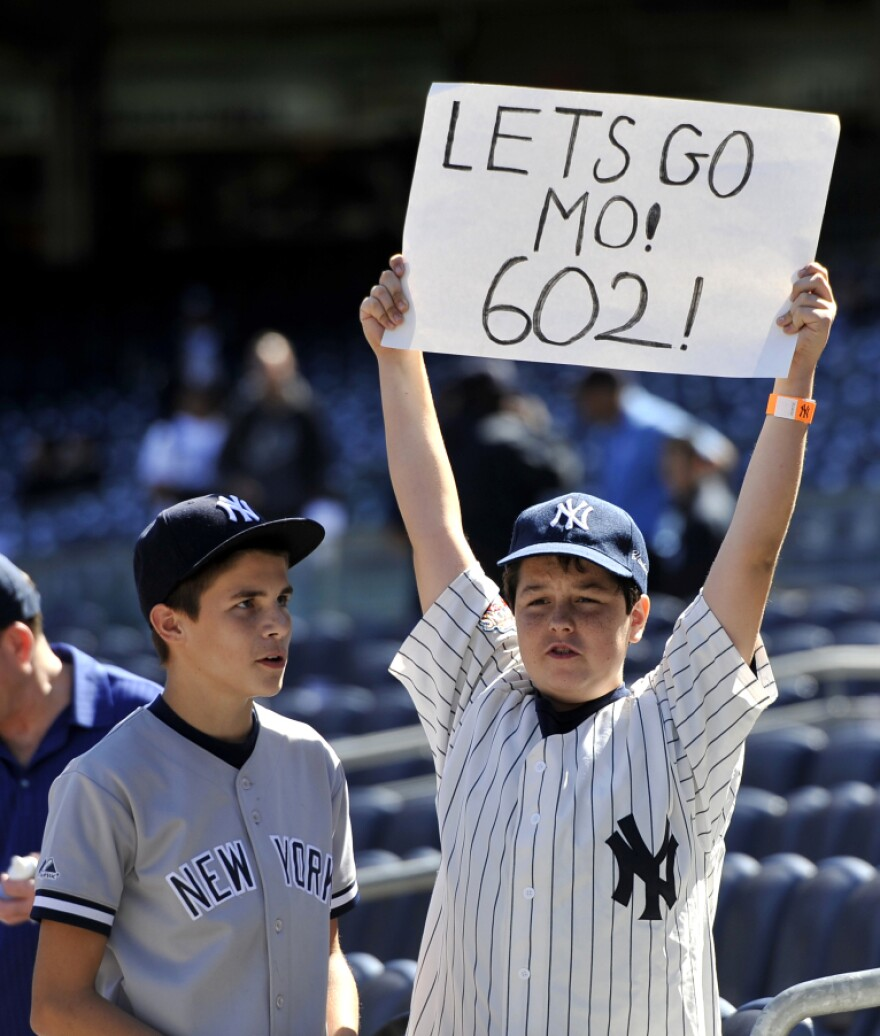 Alex Peluso, right,  and his friend Chris Filomio,  of Wappinger Falls, N.Y. show their support for New York Yankees pitcher Mariano Rivera during batting practice.