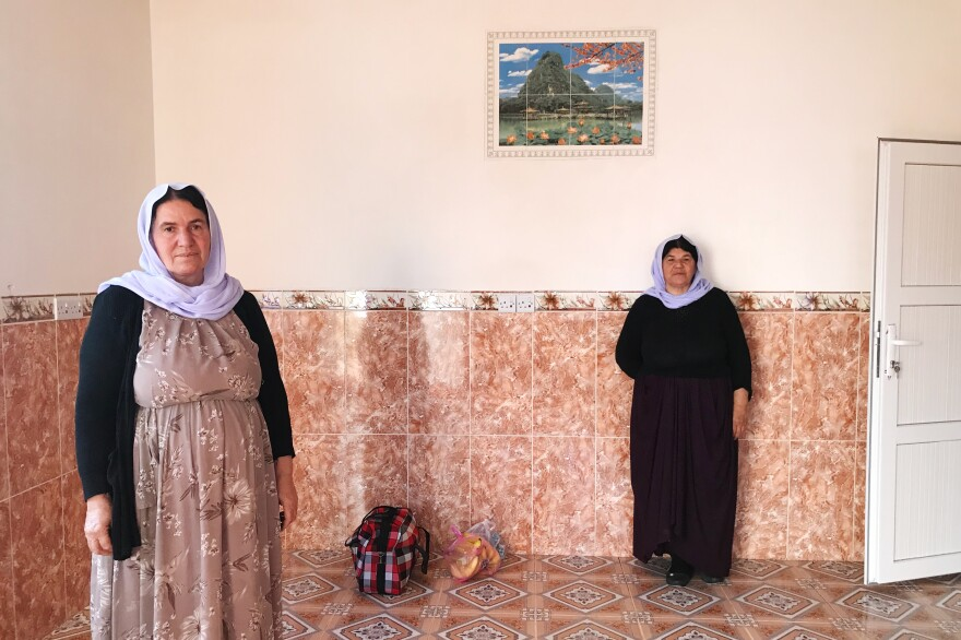 Nofa Khudeda (left) and a neighbor in the village of Tel Qasab on the day Khudeda and her husband returned after six years in a camp for displaced Yazidis. Khudeda and her husband, Ali Edo, repaired and renovated the house, which had been looted by ISIS fighters and then militias that fought ISIS.