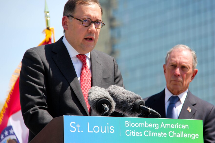 Washington University Chancellor Andrew Martin speaks at a press conference with former New York Mayor Michael Bloomberg in May 2019 about climate change.