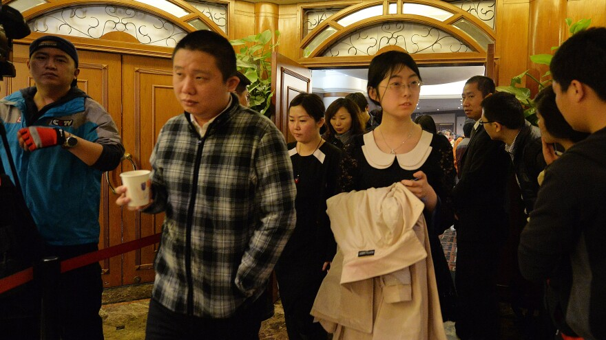 Relatives of Chinese passengers from the missing Malaysia Airlines flight MH370 met officials at a Beijing hotel Sunday. The flight disappeared from radar more than a week ago.