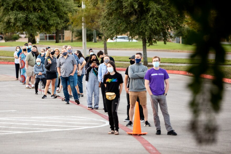 Voters in line on the first day of early voting in Texas at Southpark Meadows shopping center in South Austin.