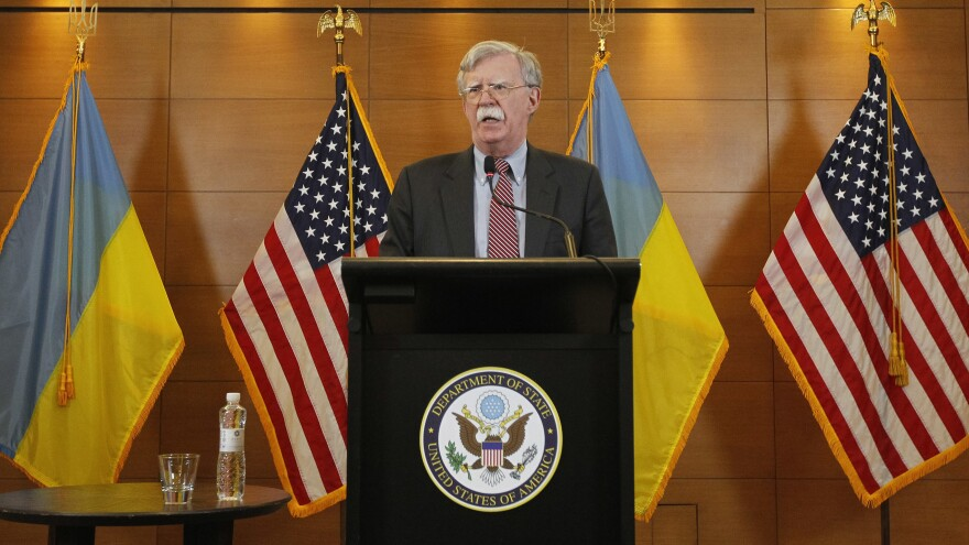 Then-national security adviser John Bolton speaks during a media conference in the Ukrainian capital of Kyiv on Aug. 28, 2018. Bolton, a lifelong Russia hawk, has been described as objecting to Trump's Ukraine policy: Holding up military assistance intended to help Ukraine resist Russian military activity was antithetical to Bolton's worldview.