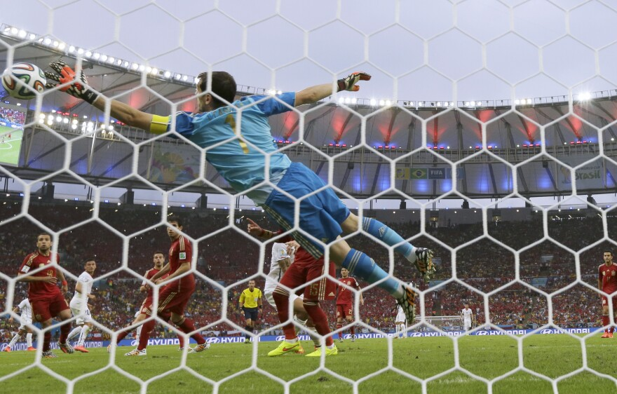 Spain's goalkeeper, Iker Casillas, fails to save an attempt by Chile's Charles Aranguiz at the Maracana Stadium in Rio de Janeiro on Wednesday.