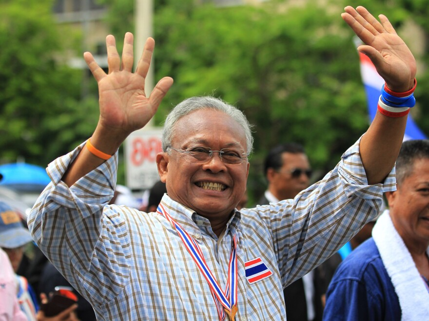 Suthep Thaugsuban waves to supporters during a mass rally in Bangkok, the same day the army declared martial law. Suthep says he acted as an adviser to the army general who subsequently seized power.