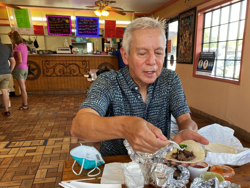 Adán Medrano, chef and food writer, savors a beef cheek taco at Vera's Backyard Bar-B-Que in Texas' Rio Grande Valley.