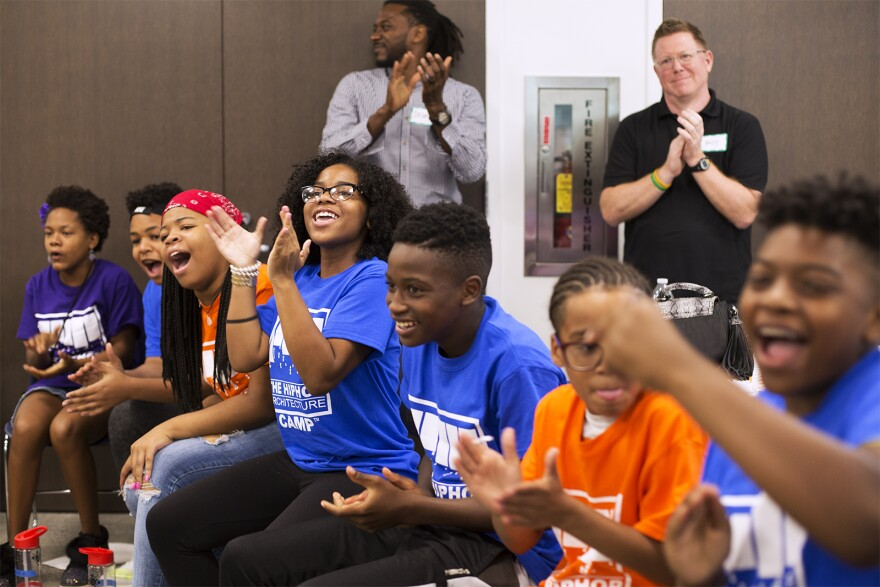Students cheer on a classmate during the class' rap battle.