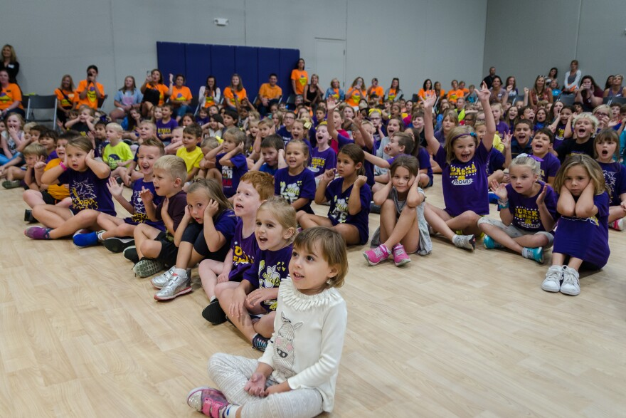 Students cheer during a ribbon-cutting ceremony for Rockwood School District's new Eureka Elementary School on Aug. 28, 2019.
