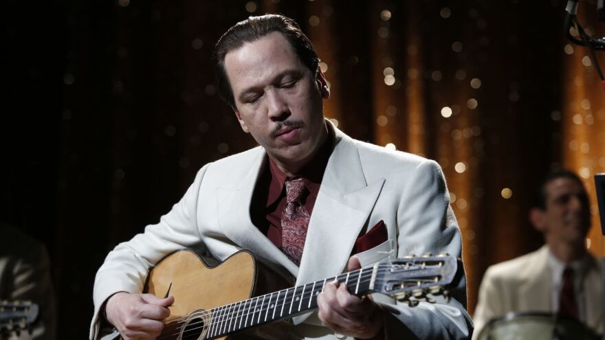 Melody, Unchained: Reda Kateb plays Django Reinhardt — and the guitar — as the music legend attempts to escape German-occupied France in <em>Django</em>.