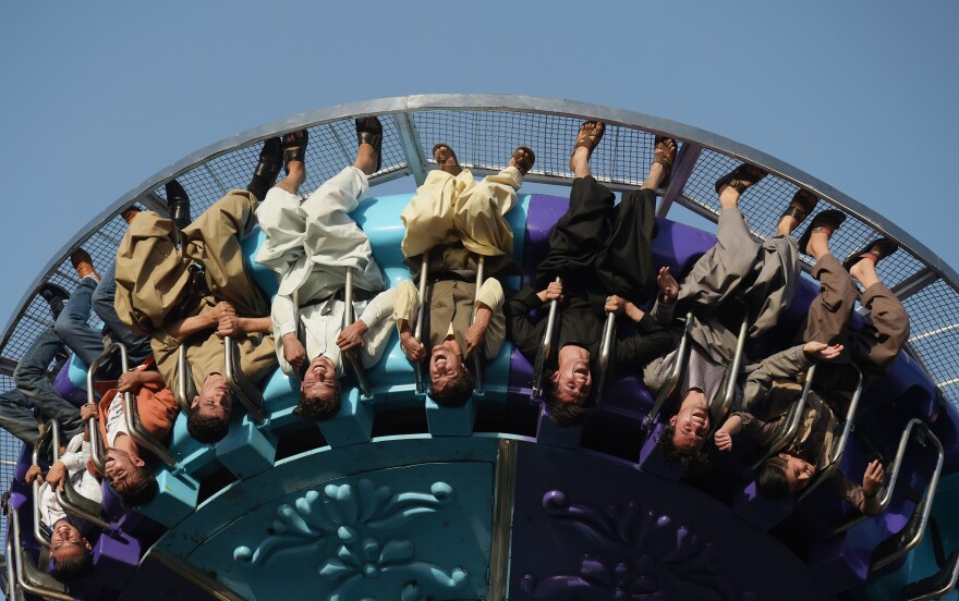 Afghans on a ride at a fairground in Kabul on Sept. 6, 2017.