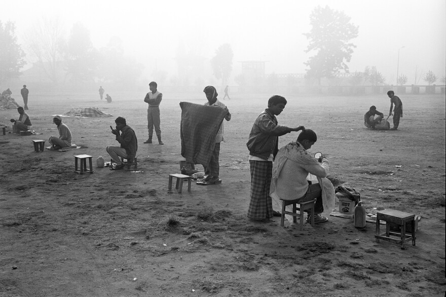 Early-morning, open-air haircuts were a Nepali tradition in 1989, when this photo was taken. The stretch of open green in the city of Kathmandu, called Tundikhel, is now reportedly a camping ground for earthquake survivors.