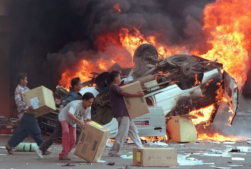 Angry Indonesian mobs burn cars and Chinese shops in Jakarta on May 14, 1998. Indonesia has made great progress since the ethnic and religious violence of the immediate post-Suharto era.