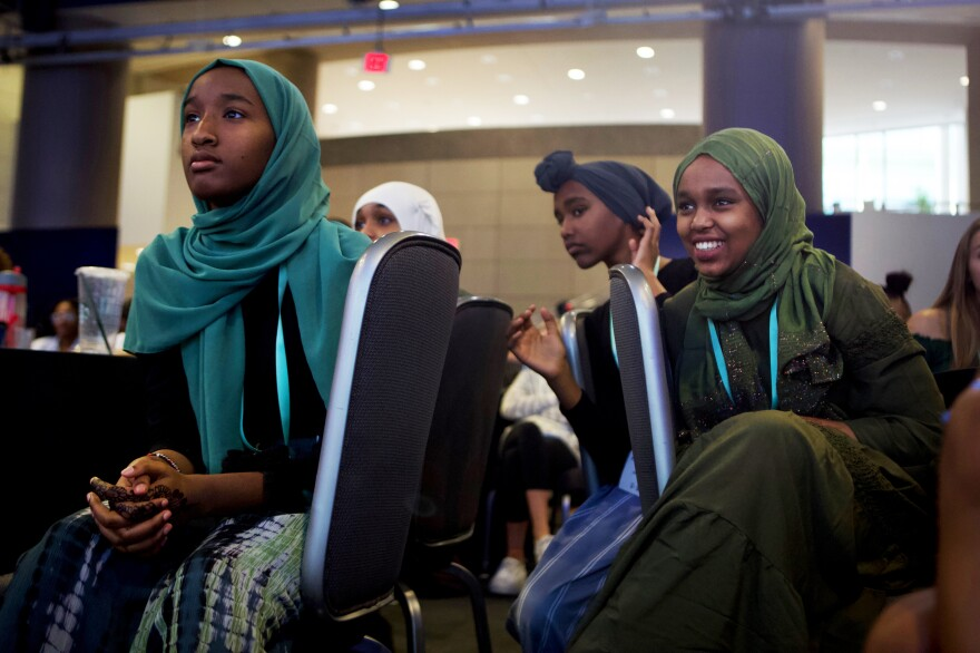 From left, Edman Ali and Naima Yusuf, both 14, listen to a panel at the Girl Up 2019 Leadership Summit.