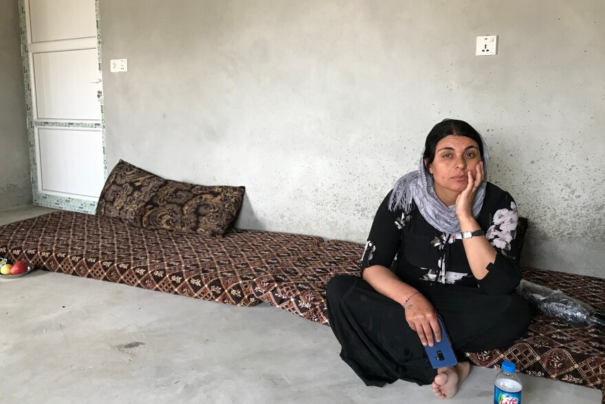 """Kamo Zandinan sits in a friend's home in a village in Sinjar in northern Iraq. She believes an older daughter is alive and still in Iraq. The girl was 13 when she was taken by ISIS. """"I told them she is sick, but they tore her clothes in front of me,"""" says Zandinan. """"We were holding onto each other but they beat me with a stick and she fell on the ground and I couldn't do anything."""""""