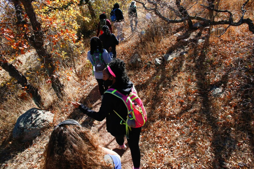 Members of Vibe Tribe Adventures, an organization founded in Colorado to encourage Black women to participate in outdoor excursions, hike through Bear Creek Regional Park on Oct. 24 in Colorado Springs.