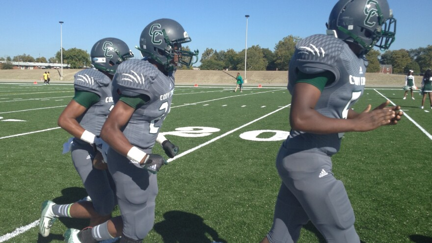 In Detroit, members of the Cody High School Comets start the football season on their own field.