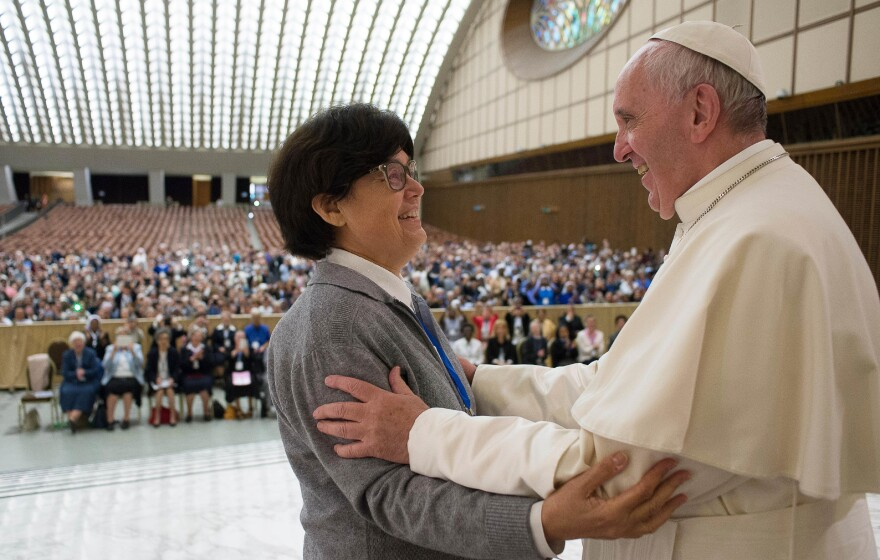 Pope Francis hugs Sister Carmen Sammut, a missionary sister of Our Lady of Africa, at the Vatican on May 12. The pope said he was willing to create a commission to study whether women can be deacons in the Catholic Church, signaling an openness to letting women serve in ordained ministry currently reserved to men.