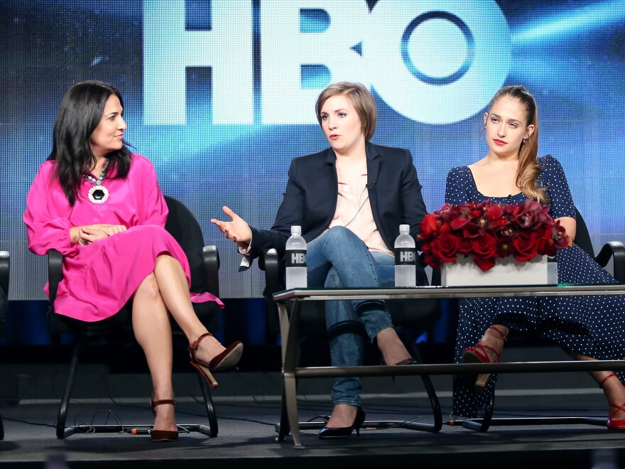 <em>Girls</em> executive producer Jenni Konner (from left), creator and star Lena Dunham and actress Jemima Kirke take questions on the first day of the Television Critics Association winter press tour.