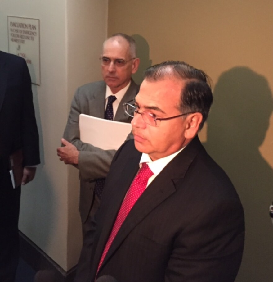Cantero (left) speaking after the hearing.