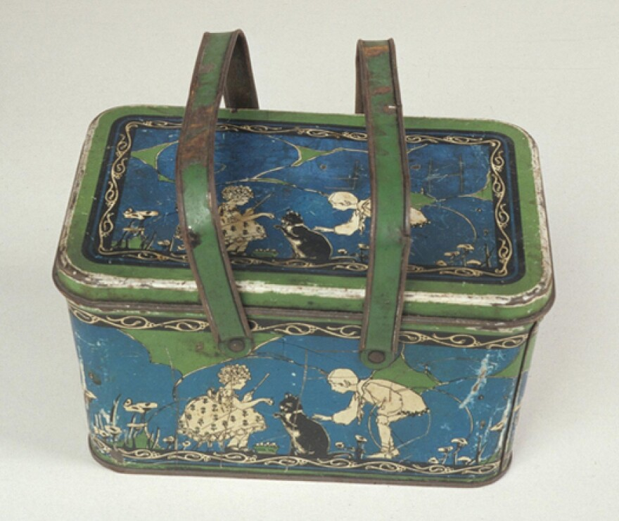 This tin-plated steel lunch box was manufactured by the Ohio Art Company in the 1920s.