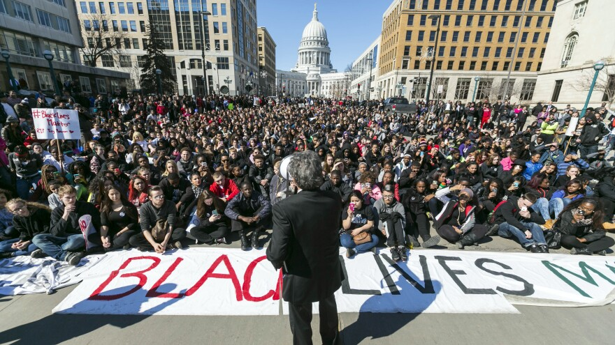 Madison Mayor Paul Soglin addresses a crowd of protesters on Martin Luther King Boulevard in Madison, Wis., during a protest of the shooting death of Tony Robinson.