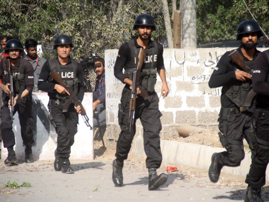 Pakistani police respond outside the Chinese consulate after an armed attack on Nov. 23.