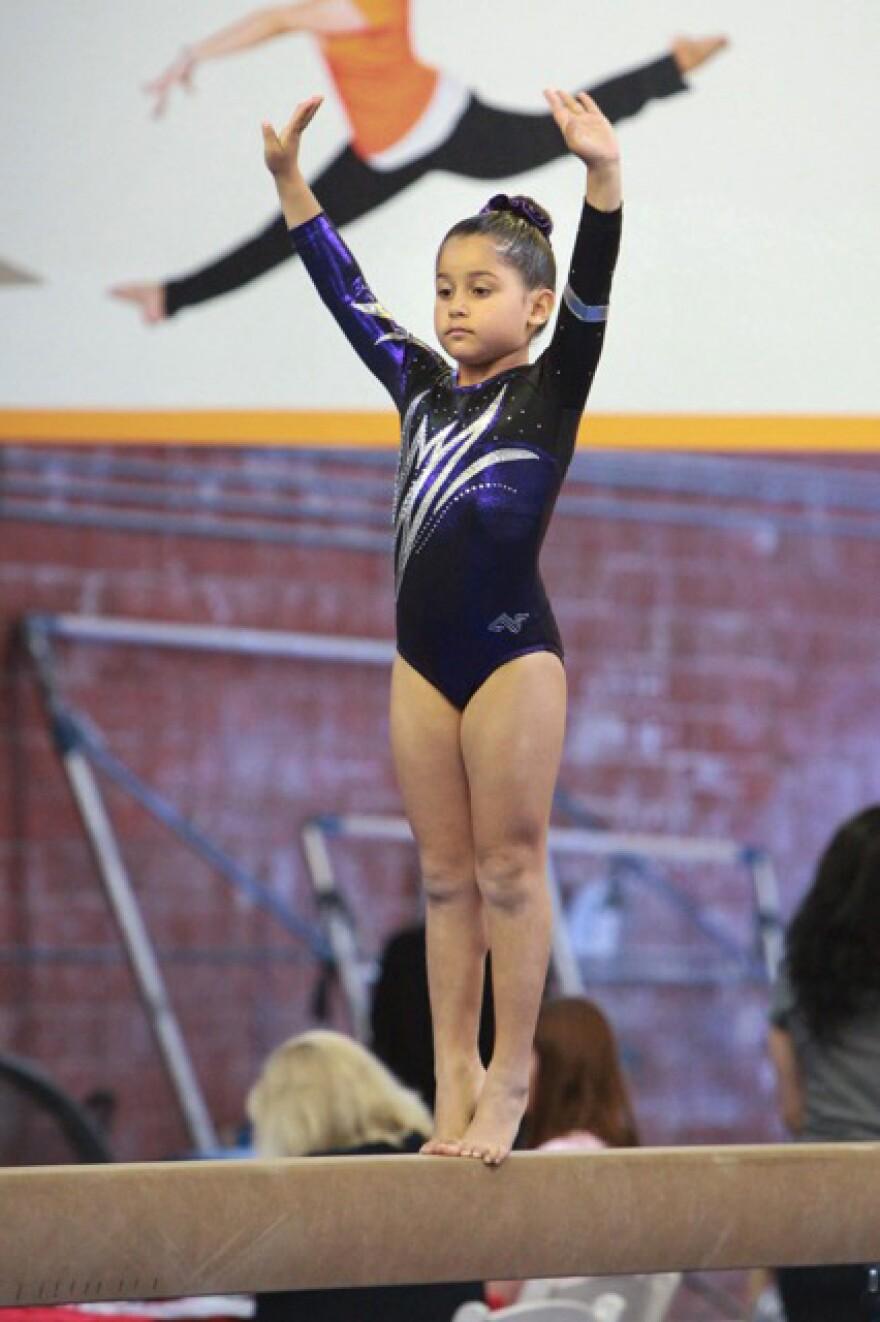 Eight-year-old Alyssa Herrera competes in gymnastics.
