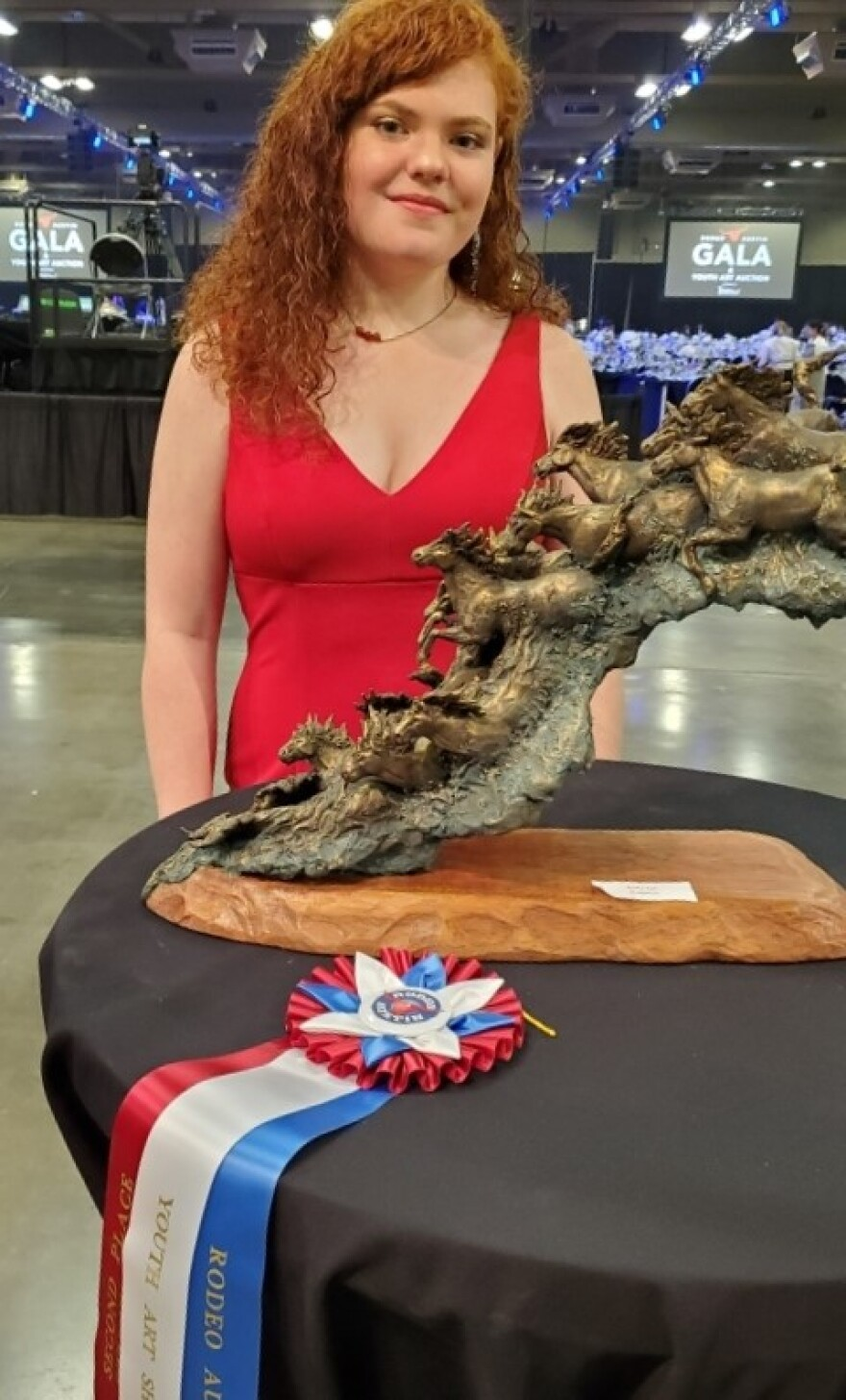 """Brenna Richardson with her sculpture """"Thunder and Flow."""" She was awarded second place at the Austin rodeo's art competition."""