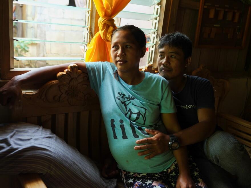 Risa Calibuso and her husband, Michael Calibuso, at home in Abinganan.