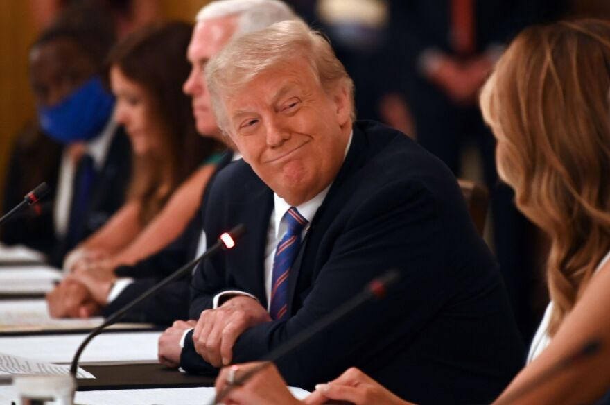 President Trump, seen here at a roundtable discussion at the White House on Tuesday, rebuked the CDC for its guidelines on reopening schools in a tweet Wednesday.