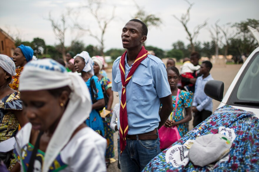 A scout, engaged to act as security, sings during an event at Notre Dame Cathedral in Bangui.