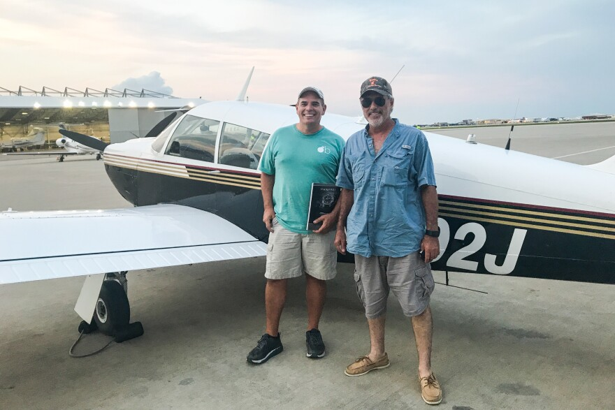 """Pilots Andy Cook (left) and Rocky Breaux flew in from Houma, La. with diapers, toys, games, books and strollers packed. They were part of the ad hoc """"Cajun Airlift."""""""