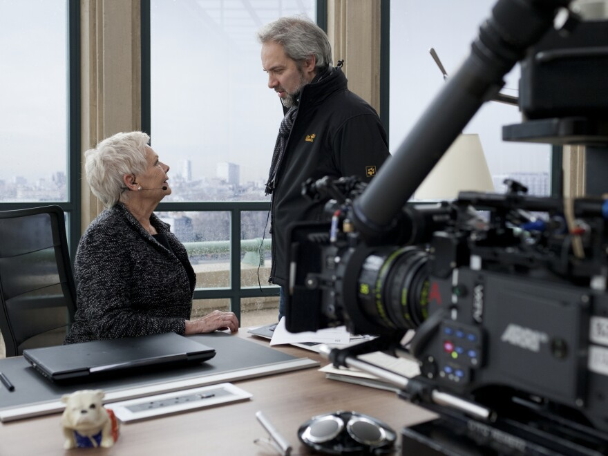 Mendes on the set of <em>Skyfall</em> with Judi Dench, who plays M.