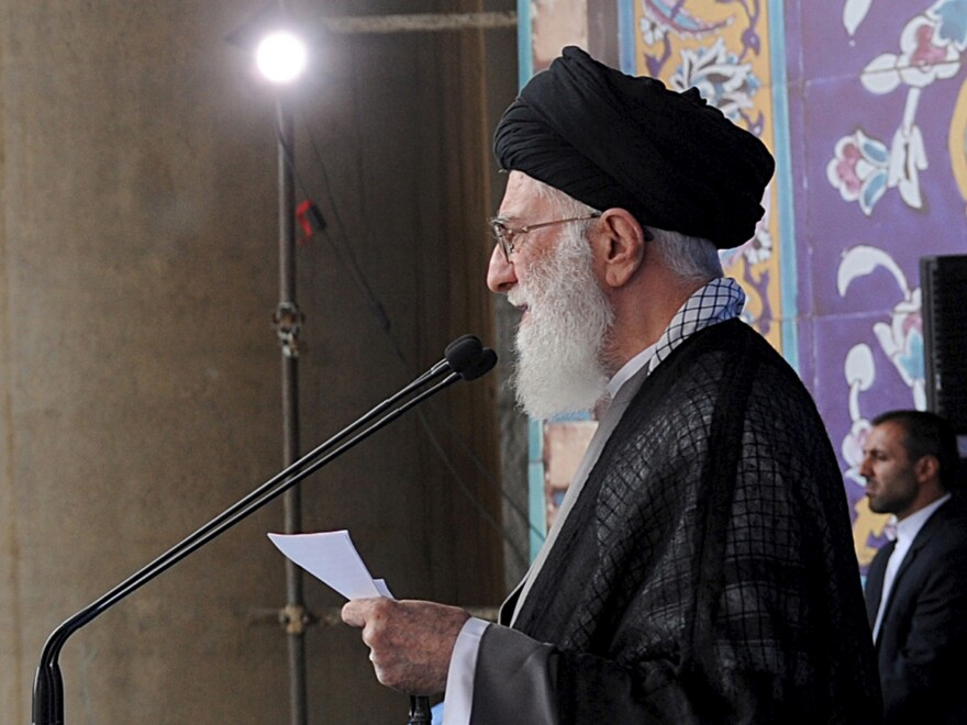 """Iran's Supreme Leader Ayatollah Ali Khamenei delivers a sermon during morning prayers for the Eid al-Fitr holiday, marking the end of the holy month of Ramadan. He signaled his approval of the nuclear agreement with Western powers but reiterated that Tehran's policy toward the """"arrogant"""" United States would not change."""