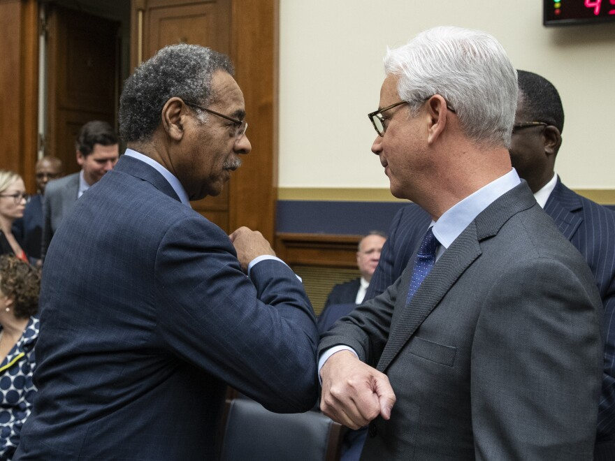 Rep. Emanuel Cleaver bumped elbows — the new alternative handshake — with Scharf before he testified during a hearing of the House Financial Services Committee on Capitol Hill.