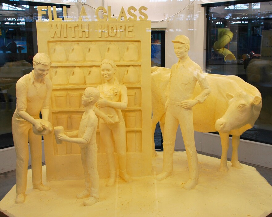 "<strong>Art of the people: </strong><em>Fill a glass with hope</em>, a butter sculpture crafted by Jim Victor and Marie Pelton. ""People don't understand how [the sculpting] is done --€"" it's like magic and just appears,"" Victor says. ""But people understand butter."""