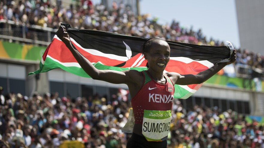 Kenya's Jemima Sumgong celebrates after winning the gold medal in the women's marathon Sunday in Rio in a time of 2:24:04. Despite Kenya's wealth of distance running talent, she's the first from her country to win the women's marathon since it was introduced to the Olympics in 1984.