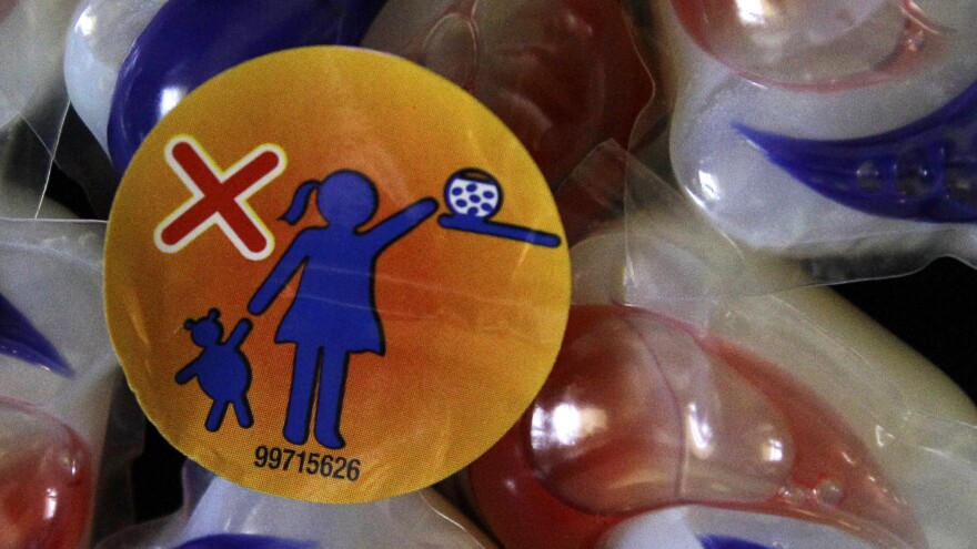 A label warns parents to keep Tide laundry detergent packets away from small children.