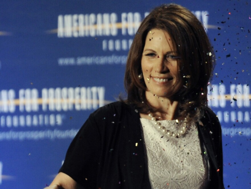 """Republican presidential hopeful Michele Bachmann is hit with a """"glitter bomb"""" after speaking at the RightOnline Conference in Minneapolis on Saturday."""