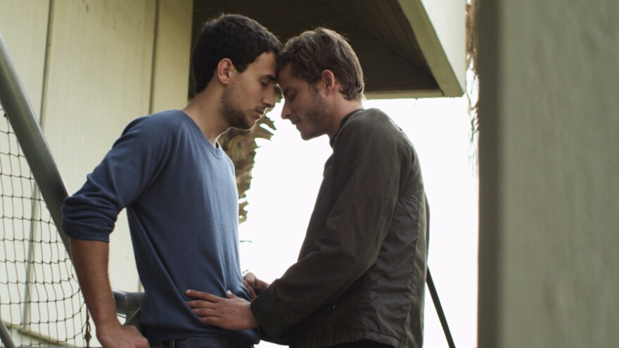 Nicholas Jacob (Nimr) and Michael Aloni (Roy) are star-crossed lovers of a different stripe in the Israeli drama <em>Out in the Dark. </em>