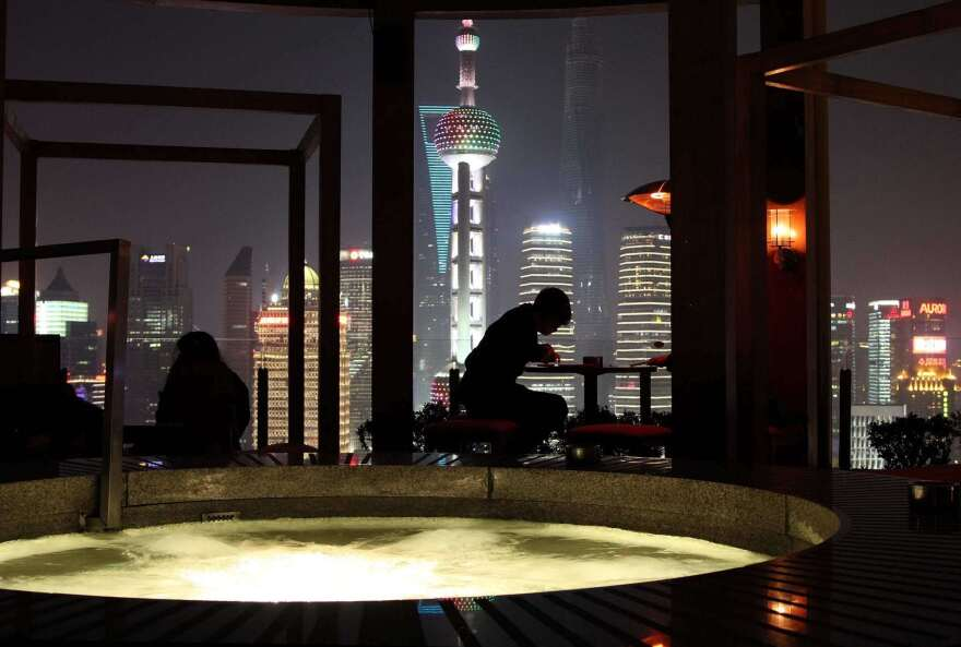The Vue Bar at Shanghai's Hyatt hotel on the Bund is known for spectacular views and its outdoor hot tub.