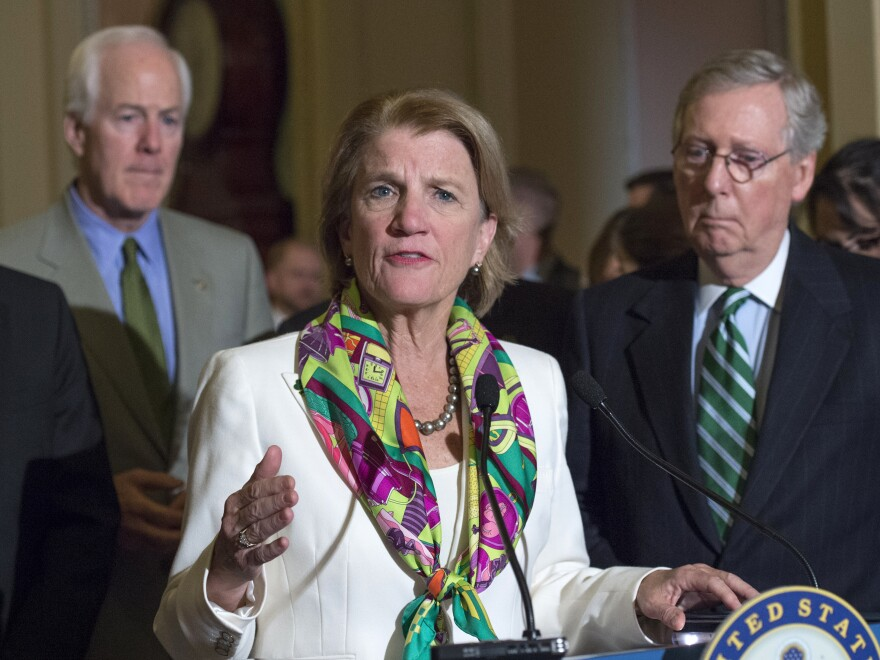 Sen. Shelley Moore Capito, R-W.Va. — shown with Senate Majority Whip John Cornyn (left) and Senate Majority Leader Mitch McConnell in 2015 — represents the state with the highest per-capita death rate from opioids.