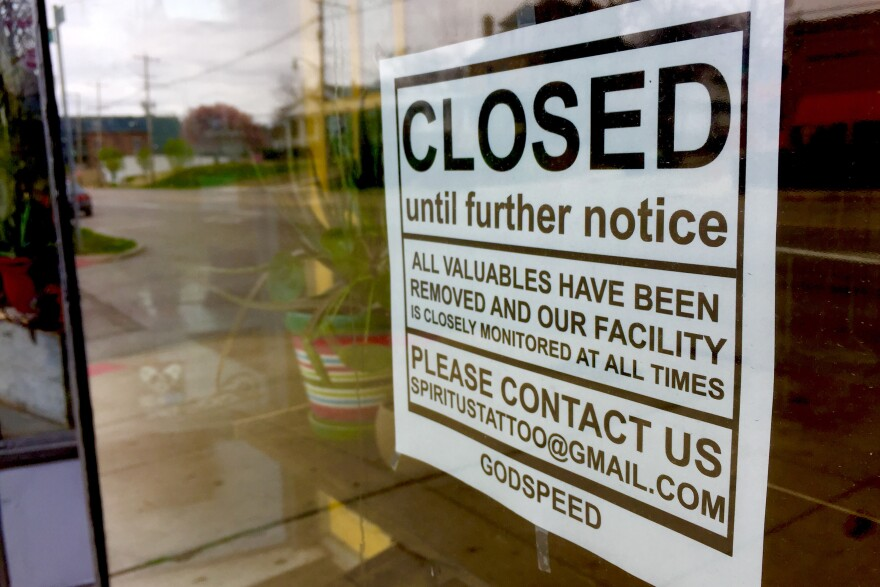 Spiritus Tattoo, a tattoo parlor in Clintonville, is closed as a non-essential business. A sign posted on the storefront window cautions would-be criminals that all valuables have been removed.