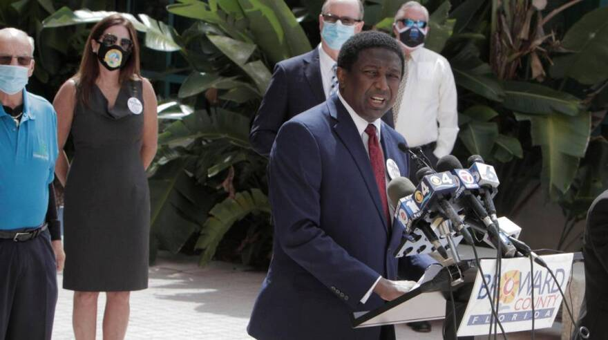 Broward County Mayor Dale Holness, joined by the mayors of nine cities, Sheriff Gregory Tony and other officials, announced stricter enforcement measures for businesses not complying with emergency orders related to COVID-19 at a press conference.