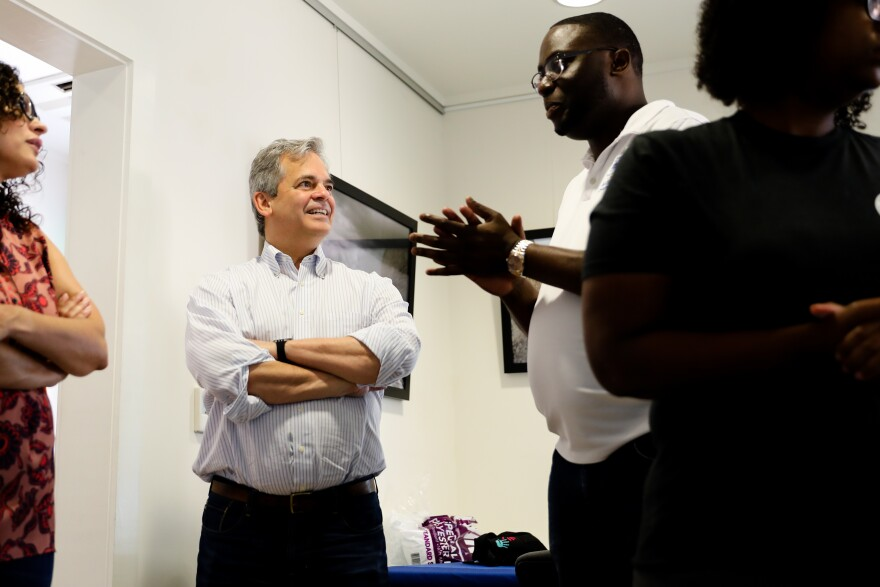 Mayor Steve Adler talks with Gregory Gibson Jr. Adler initially put out the call for so-called welcome kits for Harvey evacuees, but the kits didn't include hygiene products for black hair and skin.