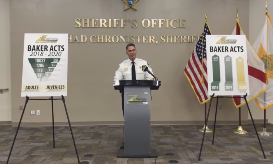 Sheriff Chronister stands in front of a podium to discuss a a unit behavioral resources unit.