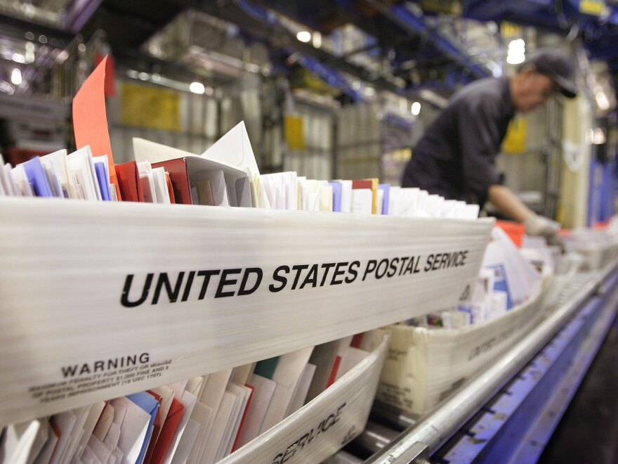 A Chicago man has been charged with mail fraud and mail theft after allegedly changing UPS's corporate mailing address to the address of his own apartment. Here, mail is sorted at Chicago's main post office in 2006.