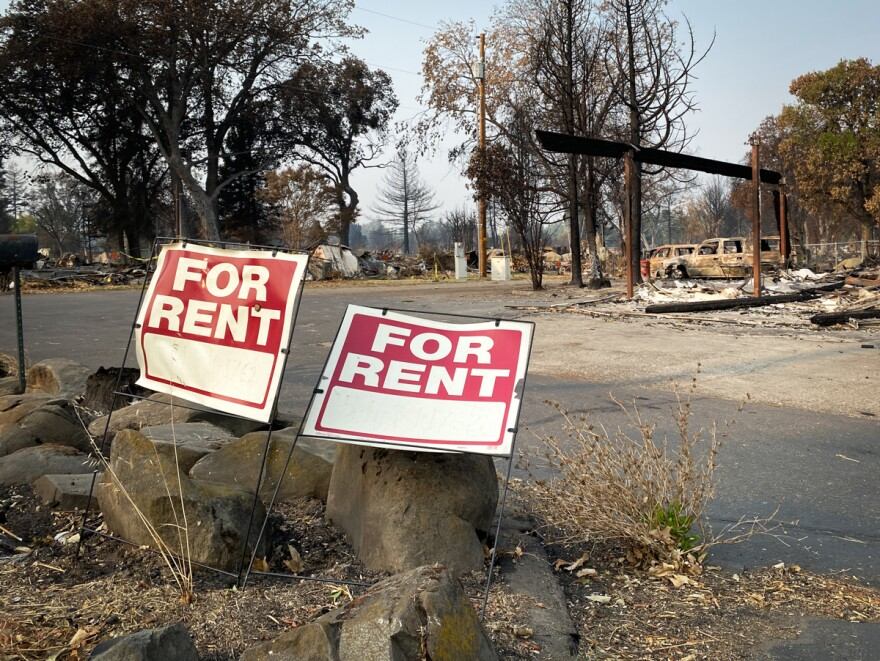 Rent signs near a mobile home park in Phoenix that was entirely destroyed by the Almeda Fire