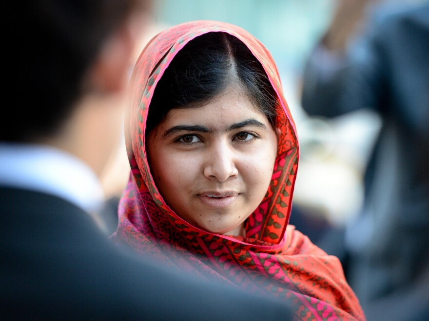 Education advocate Malala Yousafzai arrives at the U.N. headquarters in New York, in August.
