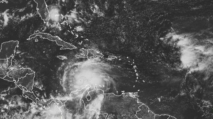 A satellite image shows Hurricane Matthew's location around midday Saturday. The storm is expected to move to the north and northwest.